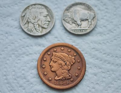 Two Indian head Nickels and One 1854 One Cent