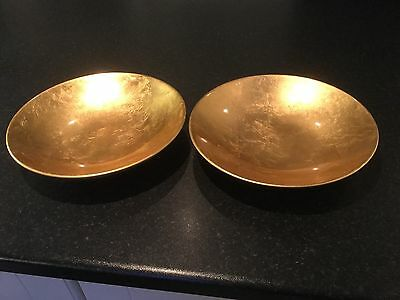 Two decorative gold coloured bowls