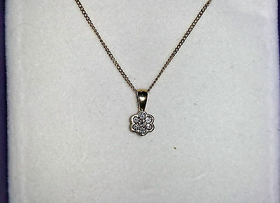 18ct yellow gold diamond pendant and 18ct yellow gold chain