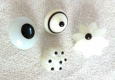 Four Antique White w/ black Glass Swirlback Charmstring Buttons