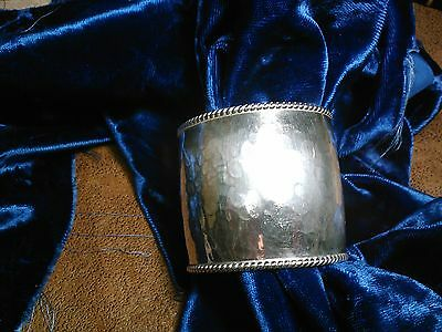 Sterling Silver Mammered Wide Cuff Bracelet Trimmed With A Thin Silver Rope.