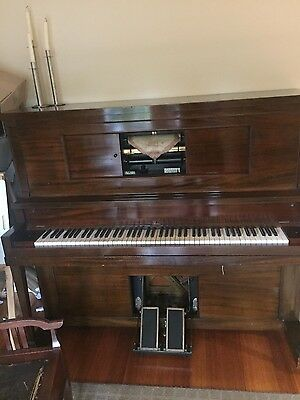 Antique pianola in good working order