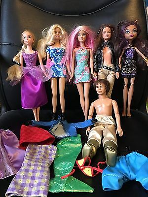 Barbie bundle of dolls with some accessories