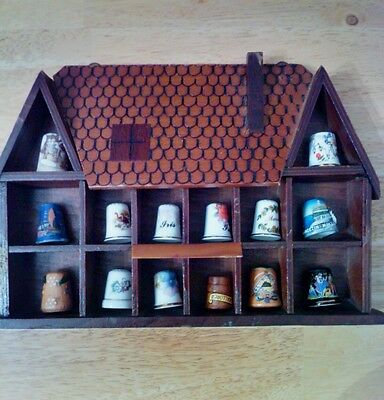 Collection of thimbles with display rack.