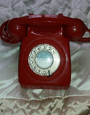 old fashion dial telephone in red