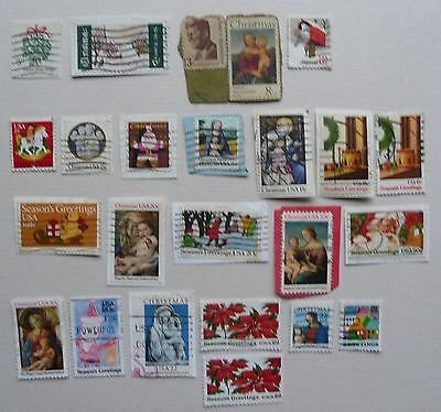 21 Christmas stamps of USA 1964-1986. Used, mostly on paper