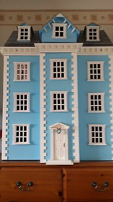 Large Dolls House With Lots Of Furniture And Accessories
