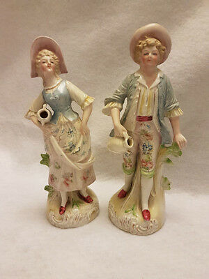 Pair of Lovely Porcelain Figurines Man and Woman with Vases