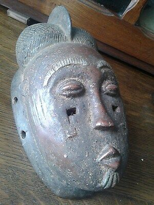 african mask with chinese influence