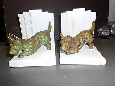 Bookends  2 dogs and they might be brass or cast bronze