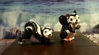 Skunk Figurines.