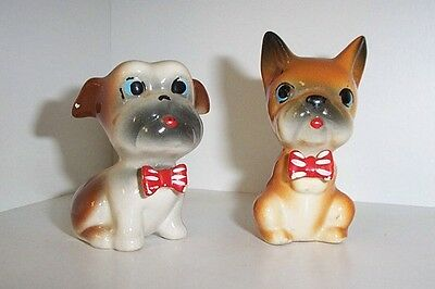 Two very cute small Boxer type dogs.