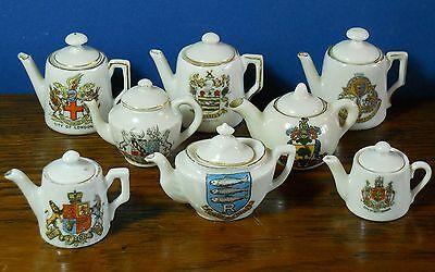A Collection of 8 miniature crested Tea/ coffee pots Gemma + Nautilus & Queens
