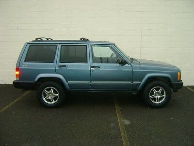 1999 Jeep Cherokee  1999 JEEP CHEROKEE SPORT 4X4 VERY LOW 84K MILES CD CHANGER SUNROOF NO RESERVE!!!