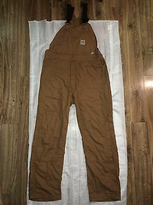 Carhartt Flame Resistant work bibs size medium/regular. Slightly used.