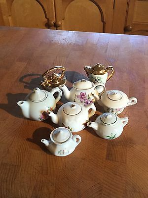 Eight Miniature China Teapots Inc. Salt And Pepper Set, And Florals