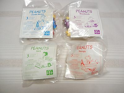 McDONALDS TOYS - - SET OF 4 - PEANUTS TOYS - 1989 - NEW IN PKG.