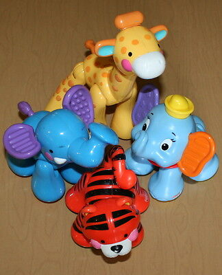 4 Sing and Go Animals Tiger Elephant Giraffe Dumbo Clacking Sounds Fisher-Price