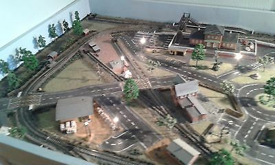 N Gauge model railway layout with 2 locos and rolling stock