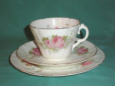 Vintage, triset with cup, saucer a. side plate, rose pattern/China/British