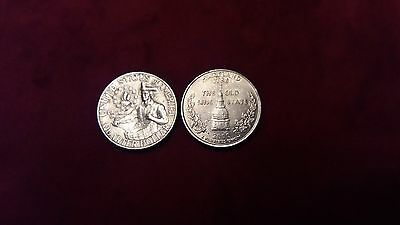 Quarter dollar coins 1976 and 2000