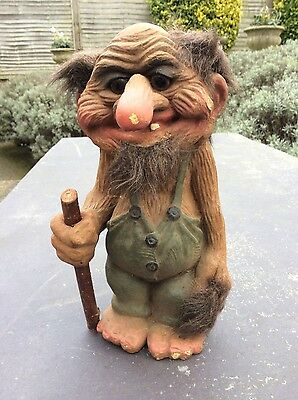 Vintage NyForm troll old bald man long nose holding stick and tail