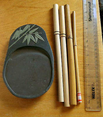 Chinese calligraphy tools. An ink stone and 4 Brushes