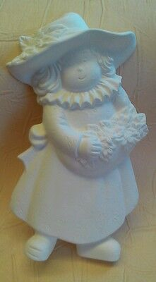 Unpainted ceramic bisque sweet girl with flowers
