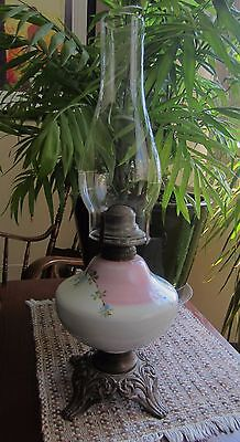 Parlor Oil Lamp with Glass Globe in Pink and White, cast metal base, chimney.