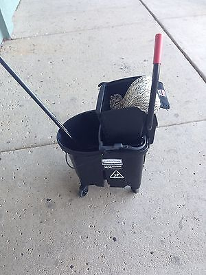 Janitorial Mop And Bucket.  By Rubbermaid.