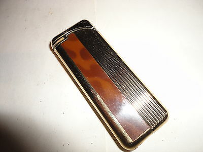 Old gold tone & mottled gas electronic very slim 2&5/8 by 1 inches by Aston