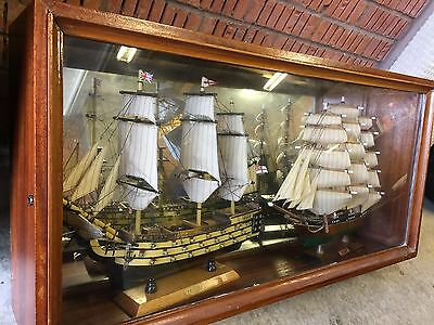 HMS VICTORY and the CUTTY SARK. Replica wooden model ships in display cabinet.