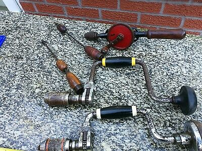 a collection of vintage drills