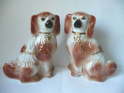 Pair Of Staffordshire Seated Russet & Cream Spaniel Dogs.