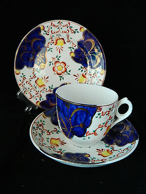 Antique Gaudy Welsh pottery trio (tea plate, cup and saucer) tulip pattern