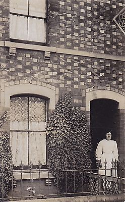 Lady Posing in front of the house Real Photograph Postcard.c.1910