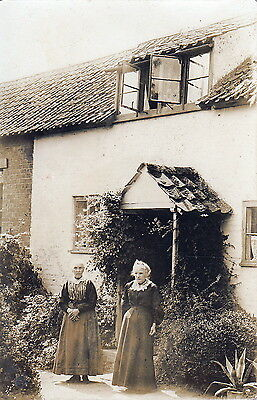 Two Ladies in front of old Cottage Real Photograph Postcard.c.1900