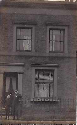 Two Lads in front of House Real Photograph Postcard.c.1910