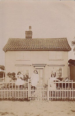 Children in front of Their Cottage Real Photograph Postcard.c.1900