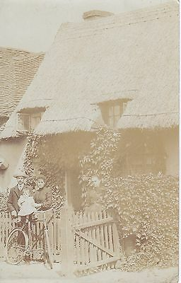 Family in front of their Thatched Cottage Real Photograph Postcard.c.1900