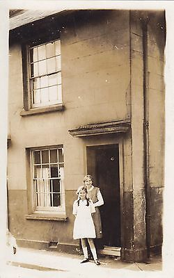 Mother & Daughter in front of their house Real Photograph Postcard.c.1910