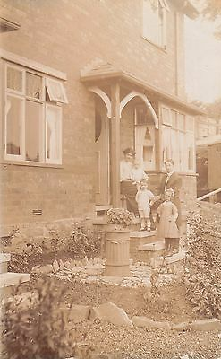 Great Photo family in front of their house Real Photograph Postcard.c.1910