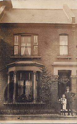 Father & Son in front of their house Real Photograph Postcard.c.1910