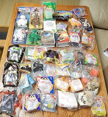 LOT OF 50 McDONALD'S HAPPY MEAL TOYS - MANY VINTAGE - HAVE A LOOK - NEW IN PKGS