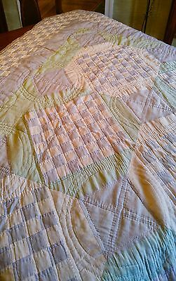 vintage handcrafted quilt in blue and green pastel