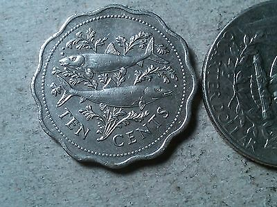 Bahamas 10 cents 1987 Scalloped shaped coin. Fish