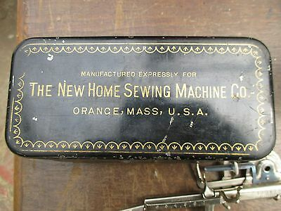 Vintage New Home Treadle Sewing Machine Tin Box with Some Attachments