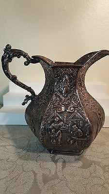 "E.G  Webster & Son repousse figural 8""  water pitcher"