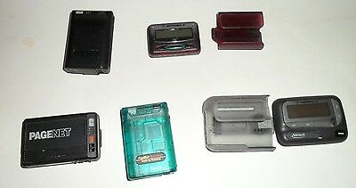 Motorola Pagers 5 different ones 2 with holders