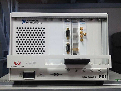 National Instruments NI PXI-1033 CHASSIS w/ PXI8432-2 and PXI 2554.